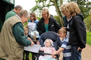 Volunteer educating a family about Westonbirt Arboretum